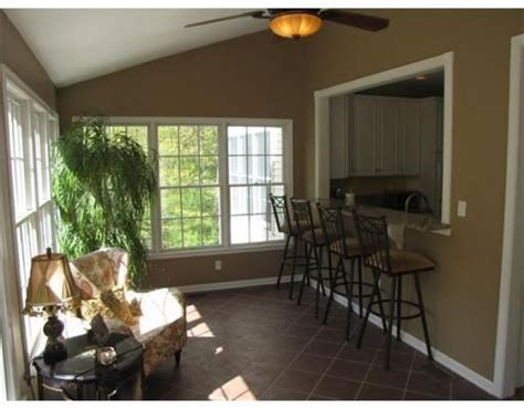 reno sunrooms kitchen with bar opening into sunroom home reno family