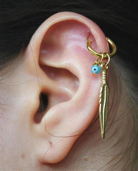 cartlidge hoop gold feather cartilage piercing earrings cartilage