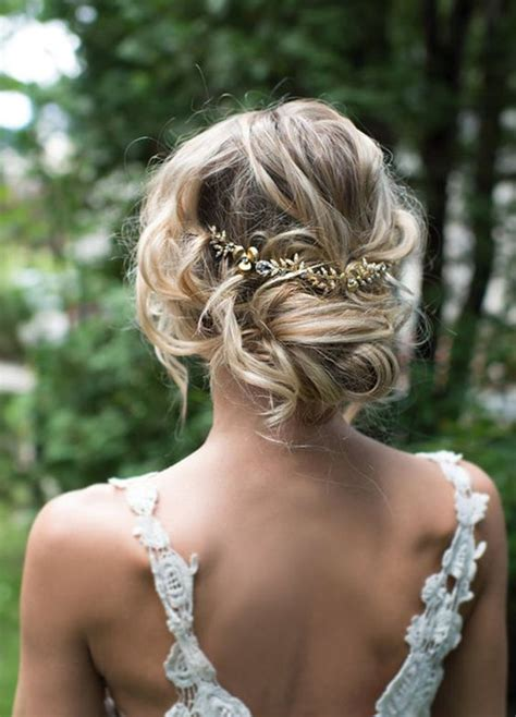 low updo gold leaf hairpiece wedding hairstyle modwedding