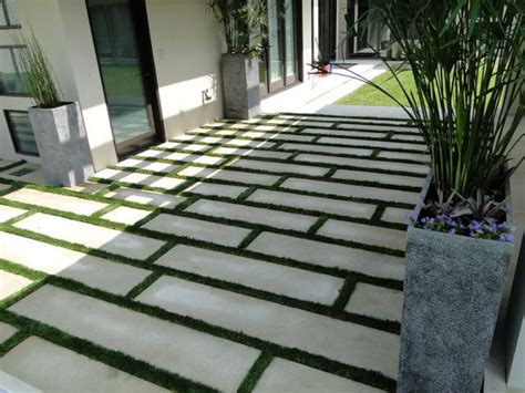 grass and pavers outdoor spaces