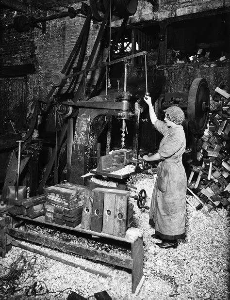 woman operating drill press boring machine boring