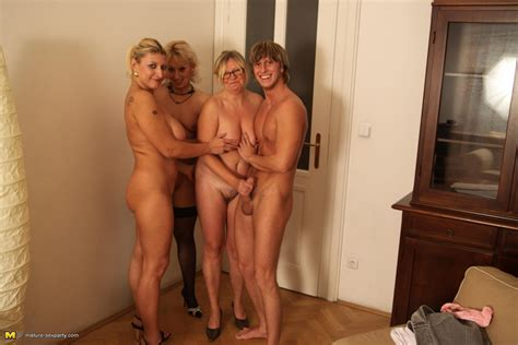 handsome blond guy is sandwiched between thee sex crazed matures who want his dick badly