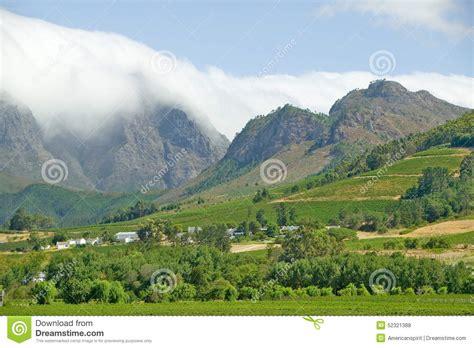clouds cover mountains  stellenbosch wine region