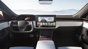 Tesla unveils new Model S with a new interior design, half a steering wheel, and a complete ...
