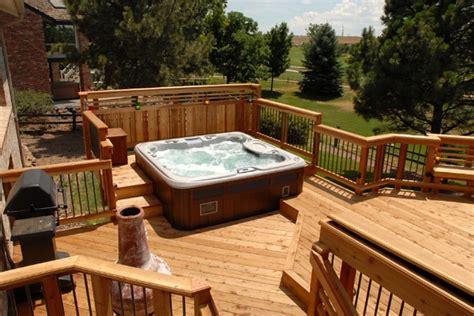 redwood deck  built  seating  hot tub unique