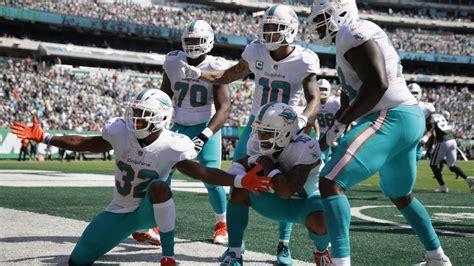 dolphins celebrate albert wilsons touchdown  photo