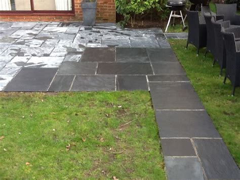 slate patio pictures tile doctor showing the results of cleaning slate on a client s patio west surrey tile doctor
