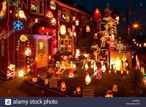 england christmas decorations on outside of house and garden stock photo royalty free image