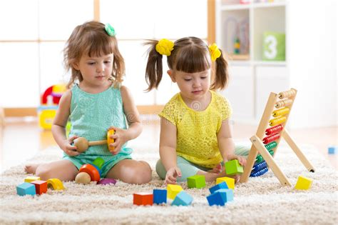 children together with building blocks 872 | children playing together building blocks educational toys preschool kindergarten kids little girls build toys h 90711453