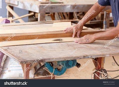 carpenter   cut wood    furniture stock