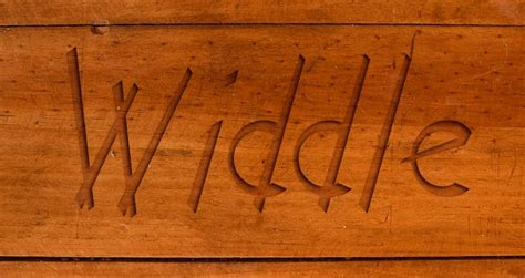 wood carving font  context restaurant logo