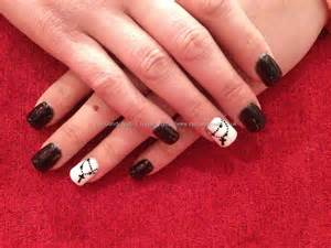Black and white acrylic nail art : Acrylic nails with black and white gel polish cross chain as nail