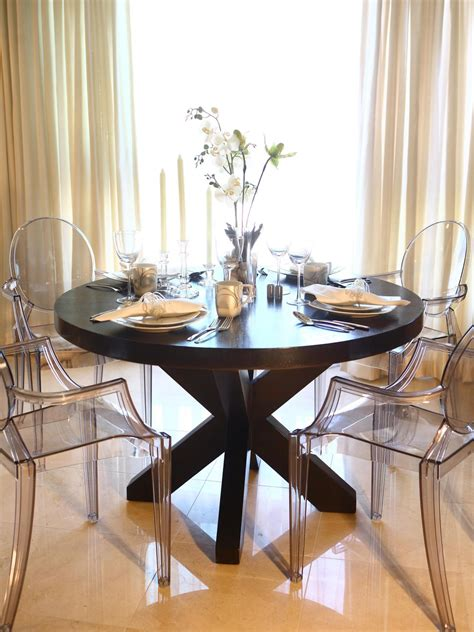 ghost chairs with wood table this elegant dining room features a large round wood