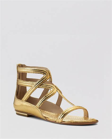 flat gold snake lyst michael kors flat gladiator sandals in metallic