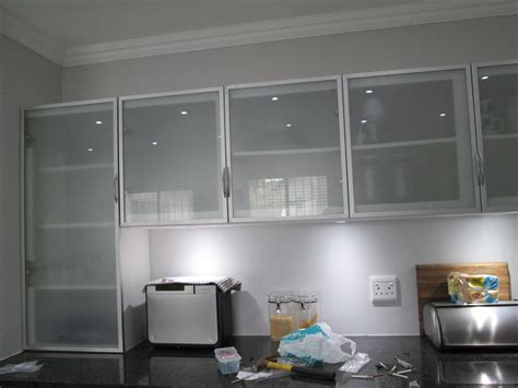 this kitchen is incorporating aluminium frame cabinet