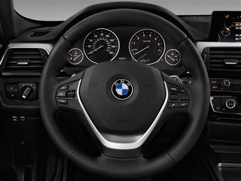 image  bmw  series  door sports wagon  xdrive awd steering wheel size