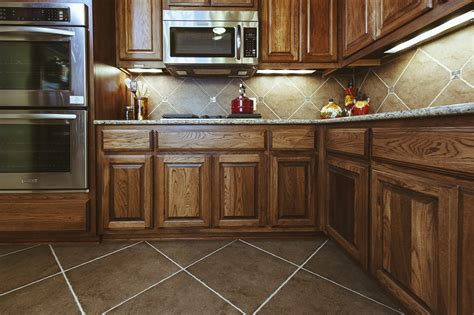stainless steel kitchen islands brown kite shape tile floor combined with brown wooden