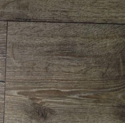 This beautiful flooring is Torlys Heathered Oak laminate