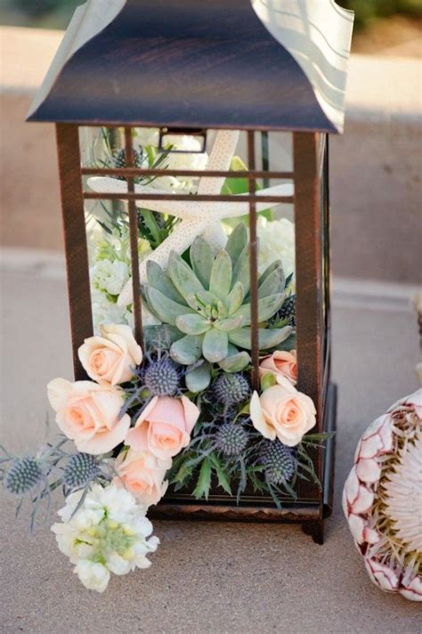 flowers and succulents inside lantern refurb the lantern