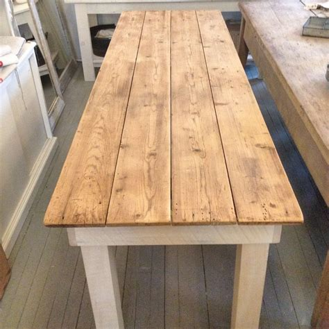 reclaimed wood farmhouse table  white flower