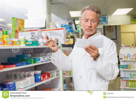 pharmacy ls for reading concentrated pharmacist reading prescription stock photo