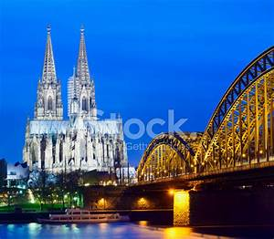 Cologne Cathedral And The Hohenzollern Bridge AT Night IN