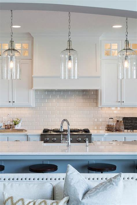 white flat front kitchen cabinets with gray marble