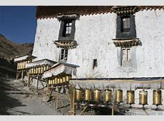 Prayer flag with the completely renewed fortress in the