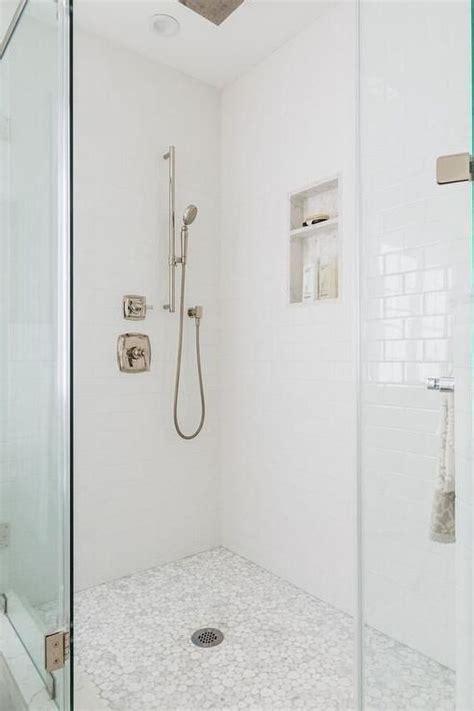 white  gray river rock shower floor tiles invite