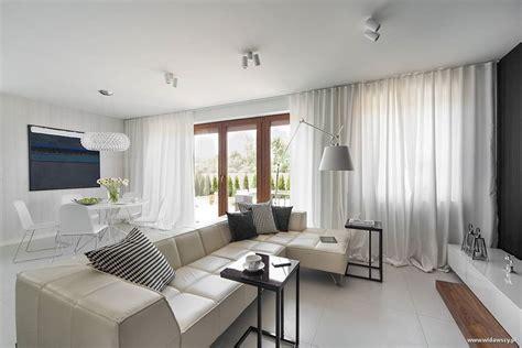 nowoczesna kuchnia  salonem  bieli architektura