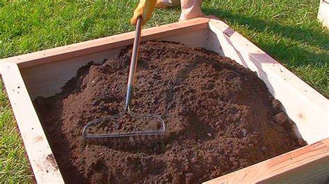 adding topsoil to garden adding garden soil compost to a raised garden bed monkeysee videos