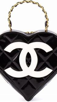 Chanel Vintage Logo Heart Clutch (10,840 NZD) liked on ...