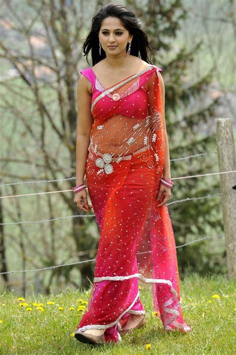 anushka navel show   transparent saree