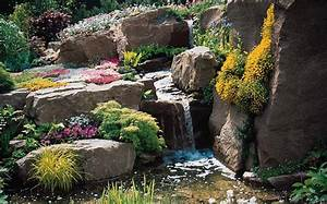 Large Backyard Landscape Design With Low Stone Waterfall ...
