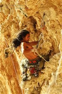 Men Climbing Mountain