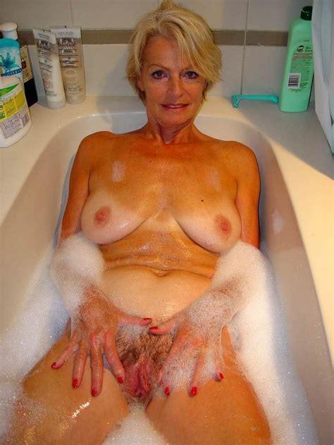 Blonde mature Justine taking a hot bath | Blonde Porn Jpg