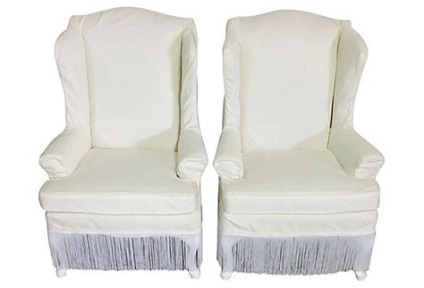 pair of white cotton slipcover wingback chairs for