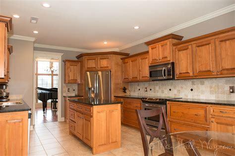 behr taupe walls maple cabinets tile floor white trim kitchen edition