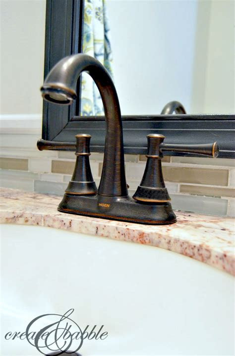 moen ashville faucet bronze powder room accessories by moen create and babble