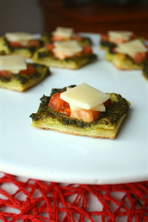 pesto puffs appetizer puff pastry pesto tomatoes and mozzarella canapes starters
