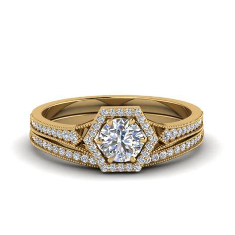 vintage hexagon halo diamond bridal set in 18k yellow gold