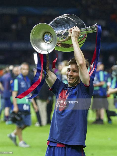 Lionel Messi of FC Barcelona with Champions League trophy ...