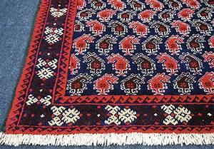 les motifs du tapis persan richesse et specificite la With tapis persan avec canapé classique