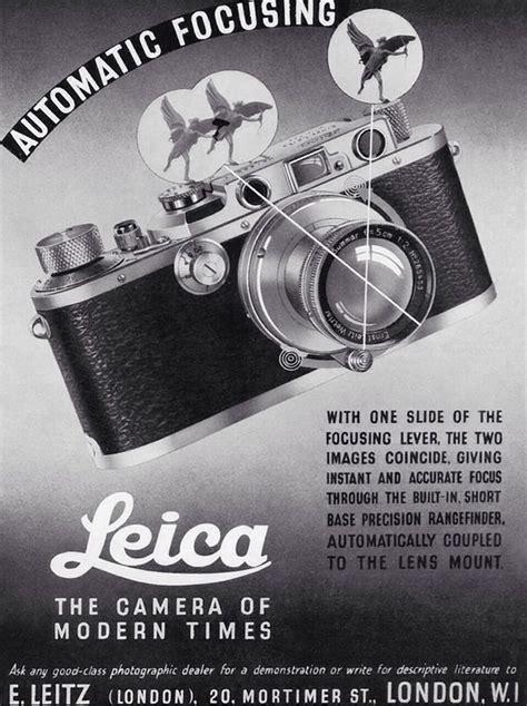 photographer autofocusing leica