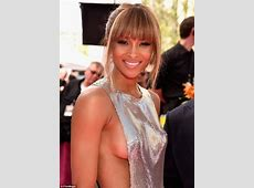 Ciara shows off her sideboob in risqué silver chainmail