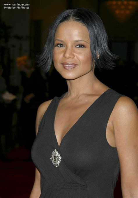 Victoria Rowell's short haircut with the ends turned out