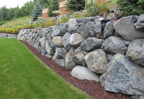 boulders for retaining wall retaining walls landscape design construction anchorage ak green acres landscaping