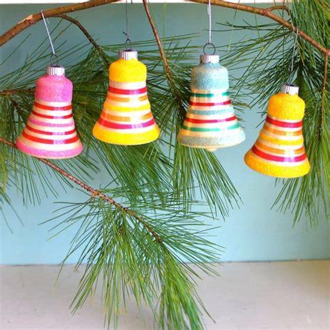 bright orange christmas ornaments striped bell shaped ornaments bright colors yellow orange holidays ornaments