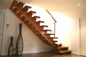 Open cantilevered stair with Split cut strings and glass