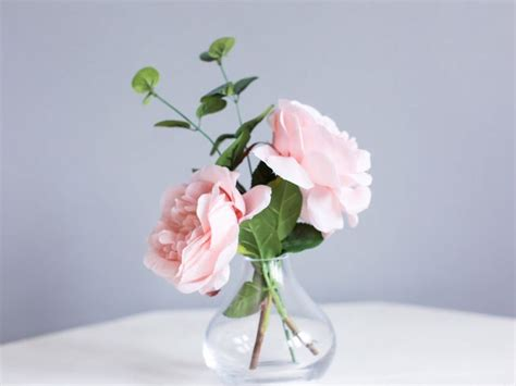 Flowers In Small Vases by Simple Arrangements In Bud Vases Using The Same Flowers As